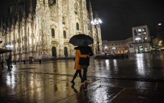 A semi-deserted Piazza del Duomo on the first evening of the curfew, from 11 pm to 5 am, decreed by the president of the Lombardy region Attilio Fontana to face the second wave of the Coronavirus epidemic, Milan,  23 October 2020. ANSA / MATTEO CORNER