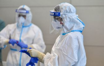 TURIN, ITALY - AUGUST 19: Personnel assigned for testing of Covid-19 at Turin airport on August 19, 2020 in Turin, Italy. The Italian government is requiring people arriving from high-risk designated countries to take a Covid-19 test, which includes regions in Spain, Greece, Croatia and Malta. According to the Ministry of Health, Coronavirus infection rates are climbing again in Italy from an average of 400 new cases per day. Authorities see Italian returning from vacation abroad as a likely strong contributor to the uptick in infections. (Photo by Diego Puletto/Getty Images)