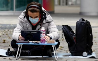 Students study on the street  in front of the Palazzo della Regione Lombardia (Regional Assembly) to protest against the closure of the school imposed by the dpcm government for the increase in covid infections, Milan, Italy, 13 November 2020. ANSA/Mourad Balti Touati