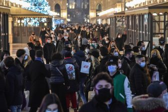 People wearing face masks walk and shop in the central area of Milan, Italy, 19 December 2020. Italian Premier Giuseppe Conte's government on 18 December announced restrictions that will put Italy into some form of a lockdown over the Christmas holidays to stop social contact during the festive season feeding a third wave of COVID-19 coronavirus pandemic in the country.  ANSA/MATTEO CORNER