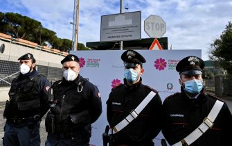 Carabinieri and Police at the entrance of the Spallanzani Hospital for the arrival of first doses of anti Covid vaccine, Rome, Italy, 26 December 2020. ANSA/RICCARDO ANTIMIANI