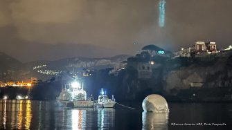 epa08951033 A handout photo made available by the press office of the Italian Coast Guard (Guardia Costiera) shows the complex operations of removal and transport of a specimen of whale identified last 17 January, in the port of Sorrento, southern Italy, 20 January 2021. The delicate activity of towing the cetacean was conducted -- under the coordination of the Maritime Directorate of Naples -- by two patrol boats of the Italian Coast Guard, which moved the specimen towards the port of Naples, where they arrived at the first light of dawn, after a few hours of navigation. The transport to the port of Naples will allow the necropsy examination necessary to more accurately identify the causes of the death of what would appear to be one of the largest specimens of whale identified in the Mediterranean.  HANDOUT EDITORIAL USE ONLY/NO SALES