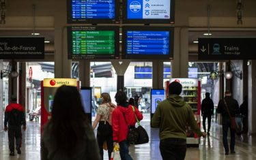Travelers pass under train departure information screens displaying details for journeys to Luxembourg and Germany as European Union (EU) travel restrictions are lifted at Gare de l'est railway station in Paris, France, on Monday, June 15, 2020. PresidentEmmanuel Macronsought to reset his presidency and accelerate Frances path out of lockdown as he faces economic strife ahead of the next presidential election in 2022. Photographer: Adrienne Surprenant/Bloomberg via Getty Images
