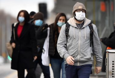 Commuters walk past Melbourne's Flinders Street Station on July 23, 2020 on the first day of the mandatory wearing of face masks in public areas as the city experiences an outbreak of the COVID-19 coronavirus. (Photo by William WEST / AFP) (Photo by WILLIAM WEST/AFP via Getty Images)
