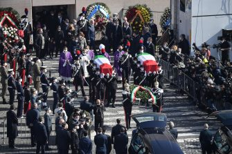 Honor guards carry the coffins of Italian ambassador Luca Attanasio and carabiniere Vittorio Iacovacci at the end of the funeral in the church of Santa Maria degli Angeli in Rome, Italy, 25 February 2021. Italian ambassador in the Congo, Luca Attanasio, and carabiniere Vittorio Iacovacci were killed in an attack in Congo on the road between Goma and Rutshuru.  ANSA/ALESSANDRO DI MEO