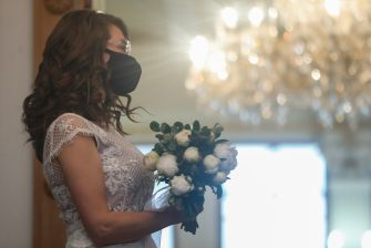 MOSCOW, RUSSIA - APRIL 26, 2020: A bride in a face mask is seen after her wedding ceremony at Moscow's No1 Civil Registry Office (Griboyedovsky) on the first Sunday after Orthodox Easter. Currently, relatives and friends are not allowed to attend marriage ceremonies due to safety measures aimed at countering the spread of the novel coronavirus disease (COVID-19), Since 30 March, Moscow has been on lockdown. The period starting from the first Sunday after Orthodox Easter is a popular time for weddings in Russia. Mikhail Tereshchenko/TASS/Sipa USA