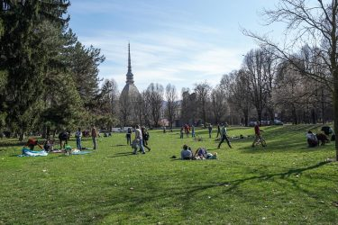People walking around the Royal Gardens take advantage of the beautiful day and the last weekend before the passage from Monday 15 March of Piedmont to the red zone, Turin, Italy, 13 March 2021 ANSA / JESSICA PASQUALON