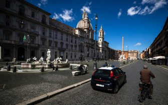 People walk in Piazza Navona during the new lockdown for emergency of the Coronavirus Covid-19 pandemic in Rome, Italy, 15 March 2021. ANSA/ANGELO CARCONI