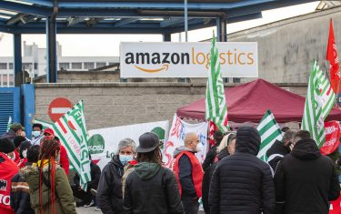 Amazon couriers attend a strike as they block deliveries and vehicles in and out of warehouses,  in front of the  Amazon logistics center HUB at Via Toffetti, in Milan, Italy, 22 March 2021.ANSA/Andrea Fasani