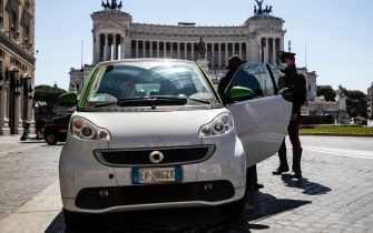 Italian Carabinieri check motorists at Venezia square during the Covid-19 pandemic emergency, in Rome, Italy, 04 April 2021. ANSA/ANGELO CARCONI