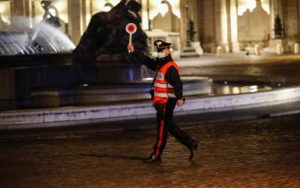 Italian carabinieri officers wearing protective masks stop cars at a checkpoint during the curfew part of the anti-coronavirus spread measures, in Rome, Italy, 8 November 2020. ANSA/GIUSEPPE LAMI