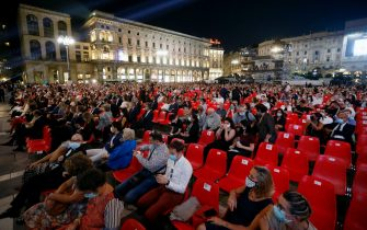 A moment of the concert of the Scala Philharmonic conducted by Riccardo Chailly, Milan, Italy, 13 September 2020. ItÂ?s the first concert in the square since the Covid-19 emergency lockdown. The stage was mounted in front of the Duomo, so that the audience, 2,600 seated spectators, can admire both the Philharmonic and the Cathedral. ANSA/Mourad Balti Touati