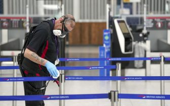 A staff member cleans in Terminal 5 at Heathrow Airport in west London ahead of international travel restarting on Monday May 17, following the further easing of lockdown restrictions. Picture date: Thursday May 13, 2021.
