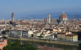 A picture taken on September 14, 2020 shows the Palazzo Vecchio (L), the Giotto bell tower or the Bell tower, the Santa Maria del Fiore Cathedral or Duomo (R) and the Arno river (down) in the center of Florence. (Photo by MIGUEL MEDINA / AFP) (Photo by MIGUEL MEDINA/AFP via Getty Images)