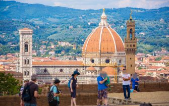 FLORENCE, ITALY - JUNE 16: Tourists and traveler visit the sightseeing point Fort Belvedere with a panoramic view on Basilica Santa Maria  Novella on June 16, 2015 in Florence, Italy. (Photo by EyesWideOpen/Getty Images)