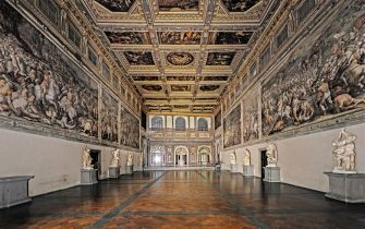 Italy, Tuscany, Florence, Palazzo Vecchio. Whole artwork view. View of the room with coffered ceiling and walls with battle scenes dedicated to the exaltation of Cosimo I de 'Medici.