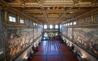 """A photo taken on February 23, 2021 in Florence shows The 15th Century Hall of the Five Hundred (Salone dei Cinquecento), the largest and most important room in terms of artistic and historic value in Palazzo Vecchio. - Florence celebrates in 2021 the 700th anniversary of the death of Dante Alighieri, who helped establish with works such as """"The Divine Comedy"""" the modern-day standardized Italian language, and set a precedent that important later Italian writers such as Petrarch and Boccaccio would follow. (Photo by Vincenzo PINTO / AFP) (Photo by VINCENZO PINTO/AFP via Getty Images)"""
