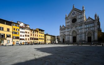 """A photo taken on February 23, 2021 on Piazza Santa Croce in Florence shows a 1865 sculpture of Italian poet, writer and philosopher Dante Alighieri (Rear C-R), by Italian sculptor Enrico Pazzi, by the Basilica di Santa Croce. - Florence celebrates in 2021 the 700th anniversary of the death of Dante Alighieri, who helped establish with works such as """"The Divine Comedy"""" the modern-day standardized Italian language, and set a precedent that important later Italian writers such as Petrarch and Boccaccio would follow. (Photo by Vincenzo PINTO / AFP) (Photo by VINCENZO PINTO/AFP via Getty Images)"""