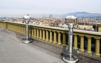 A general view taken on March 10, 2020 from a deserted Piazzale Michelangelo shows the city of Florence, Tuscany, as Italy imposed unprecedented national restrictions on its 60 million people on March 10 to control the deadly coronavirus. (Photo by Carlo BRESSAN / AFP)