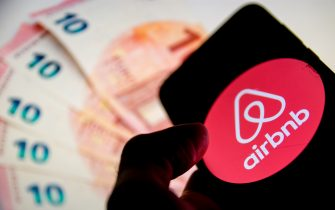 In this photo illustration a Airbnb logo is displayed on a smartphone screen and Euro bills as background on a computer screen in Athens, Greece on October 15, 2020.  (Photo illustration by Nikolas Kokovlis/NurPhoto via Getty Images)