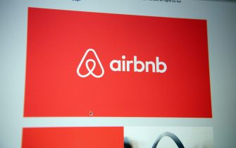 """File photo dated June 10 2020 of the logo of the Airbnb platform seen on the screen of a computer. The company's shares skyrocketed on their first day of trading, rising 113 percent above the initial public offering price of $68 to close at $144.71. That put Airbnb's market capitalization at $100.7 billion, the largest in its generation of """"unicorn"""" companies and more than Expedia Group and Marriott International combined. Photo by David Niviere/ABACAPRESS.COM"""