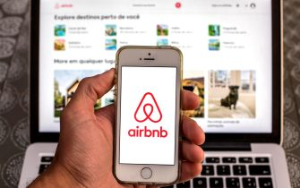 SPAIN - 2021/04/15: In this photo illustration, the Airbnb app seen displayed on a smartphone screen with the Airbnb website displayed on a laptop in the background. (Photo Illustration by Thiago Prudencio/SOPA Images/LightRocket via Getty Images)