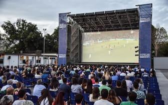 Tifosi azzurri assistono a Belgio-Italia, di Euro 2020, davanti a un maxi-schermo, a Milano