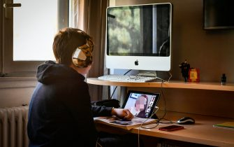 Martin, a Milanese middle school student performs lessons in DAD (Distance Learning) after entering the Lombardy Region in the reinforced orange zone, in Milan, Italy, March 05, 2021. ANSA / Andrea Fasani