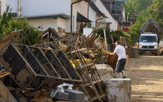 19 July 2021, Rhineland-Palatinate, Sinzig: Bulky waste piles up in the streets of Sinzig. The storm destroyed the furniture in numerous households.A bent signpost points to the Lebenshilfe house in Sinzig. Twelve people had lost their lives in the facility for the disabled as a result of the flood. Photo: Thomas Frey/dpa (Photo by Thomas Frey/picture alliance via Getty Images)