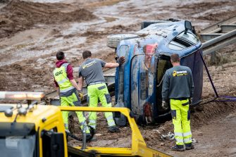 19 July 2021, North Rhine-Westphalia, Erftstadt: ADAC helpers recover a car on the 265 federal highway. Photo: Marius Becker/dpa (Photo by Marius Becker/picture alliance via Getty Images)
