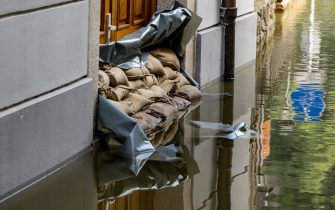 19 July 2021, Bavaria, Passau: Sandbags protect the entrance to a house on the Danube. The situation in the flooded areas in the south and east of Bavaria has eased somewhat. Photo: Armin Weigel/dpa (Photo by Armin Weigel/picture alliance via Getty Images)