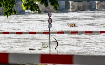 19 July 2021, Bavaria, Passau: The promenade is flooded by the high water of the Inn. The situation in the flooded areas in the south and east of Bavaria has eased somewhat. Photo: Armin Weigel/dpa (Photo by Armin Weigel/picture alliance via Getty Images)