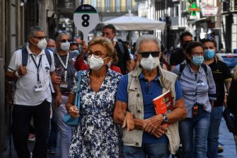 Tourists wear face masks after the southern Italian region of Campania made it mandatory to wear protective face coverings outdoors 24 hours a day, to contain the coronavirus disease (COVID-19) outbreak