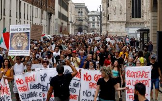 """Protesters during the demonstration against the """"Green Pass"""" in the centre of Milan, Italy, 31 July 2021. ANSA/MOURAD BALTI TOUATI"""
