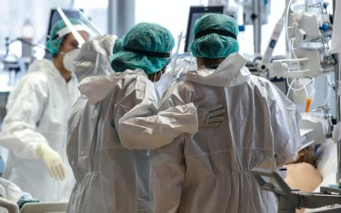Health workers wearing overalls and protective masks work in the intensive care unit of the GVM ICC hospital of Casal Palocco near Rome during the second wave of the Covid-19 Coronavirus pandemic, Italy, 28 January 2021. ANSA/GIUSEPPE LAMI