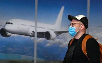 A Ukrainian tourist walks in the arrival hall of the Internatioanal Boryspil airport outside Kiev after his plane landed from China on January 30, 2020. - The first out of four special flights will be held on January 30, 2020 in order to evacuate hundreds of Ukrainian tourists from China as a deadly coronavirus outbreak grows. With no regular flights between Ukraine and China, two Ukrainian airlines, SkyUp and Ukraine International Airlines, provide charter transportation for holidaymakers to the seaside resort of Sanya on the Hainan island, but they announced a suspension of transportation after the epidemic has killed more than 130 people and spread around the world. (Photo by Sergei SUPINSKY / AFP) (Photo by SERGEI SUPINSKY/AFP via Getty Images)