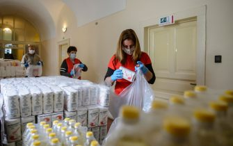 epa08393598 Members of the Caritas of the Archdiocese of Eger prepare hundreds of parcels with food to be distributed in Eger, Hungary, 30 April 2020. The Caritas of the Archdiocese of Eger provide help for 50 settlements in the territory of the archdiocese donating masks, hand sanitizers, detergents and durable food for the elderly, large families and vulnerable people stranded at home during the lockdown introduced due to the pandemic of the novel coronavirus COVID-19.  EPA/Peter Komka HUNGARY OUT