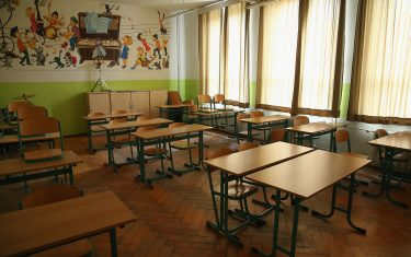 """SEIFHENNERSDORF, GERMANY - MAY 14:  A music classroom stands empty at the Middle School on May 14, 2014 in Seifhennersdorf, Germany. The state of Saxony officially closed the Seifhennersdorf Middle School in 2012 after only 38 students registered, two short of the 40 the state required to keep the school open. Rather than agree to the school's closing, a group of parents and other volunteers have since assumed the duties of teachers and staff themselves and are trying to get recognition of their """"illegal"""" school through a court case that now lies with Germany's Federal Constitutional Court. Eleven 6th graders attend the school, even though the state does not recognize their enrollment. School closings across Germany have reached epidemic proportions with 6,100 closures between 2003 and 2013, due in large part to Germany's low birth rate, a phenomenon typical across much of Europe. In Saxony the low birth rate has combined with a steady migration of young people to big cities and to western Germany and the number of schoolchildren has fallen by close to 50% and led to the closure of 1,000 out of a total of 2,500 state schools since 1989.  (Photo by Sean Gallup/Getty Images)"""