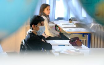 A pupil wearing a protective face mask attends a class after children returned to their classroom at Placieux' elementary school in Villers-les-Nancy, on May 12, 2020, two days after France eased lockdown measures to curb the spread of the COVID-19 pandemic, caused by the novel coronavirus. (Photo by JEAN-CHRISTOPHE VERHAEGEN / AFP) (Photo by JEAN-CHRISTOPHE VERHAEGEN/AFP via Getty Images)