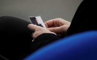 Rosa Maria Esilio, widow of Italian Carabinieri paramilitary police officer Mario Cerciello Rega, holds a photograph of her husband ahead of a hearing in the trial in which two American tourists are accused of killing Rega in Rome, Thursday, Dec. 17, 2020. Finnegan Lee Elder and Gabriel Natale-Hjorth both from California are accused of murdering the police officer during a summer vacation in Italy in July 2019. (AP Photo/Gregorio Borgia, Pool)