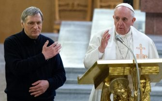 Pope Francis blesses faithfuls wearing Don Diana's stole given to him by Don Luigi Ciotti (l) at the end of a prayer vigil for victims of mafia violence in Gregorio VII's Church in Rome, 21 March 2014. Giuseppe Diana was a priest murdered by mafia. ANSA/ CLAUDIO PERI