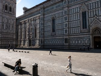 Florence, Italy May 21st 2020. View of the right side of Santa Maria del Fiore Cathedral in Piazza Duomo, during the firs days of Coronavirus phase two. Before Coronavirus struck Italy in March 2020, Piazza Duomo was always overcrowed of tourists intent to visit the Cathedral. The Cathedral was built between 1296 and 1436 A.D, during the Reinessance period. Due to the spread of the epidemic, the city of Florence is facing deep economic issues because of the lack of tourists. Tourism represent a big part of the incomes of the city.