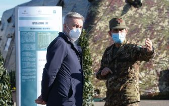 Italian Defence Minister Lorenzo Guerini (L) and Gen. Francesco Paolo Figliuolo during a visit at the first Defence Vaccination Centre set up inside the military citadel of Cecchignola, Rome 18 February 2021.  ANSA/FABIO FRUSTACI
