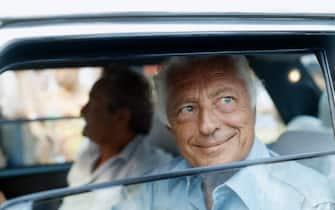©LapresseArchivio storicoeconomiaanni '80Giovanni Agnellinella foto: l'industriale Giovanni Agnelli in macchina con il  finestrino abbassato