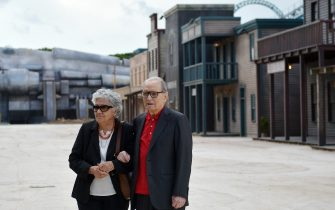 Italian score composer Ennio Morricone and his wife Maria Tavia pose during the opening of the Cinecitta World theme park at Castel Romano, south of Rome, on July 10,2014. The park was designed by Oscar- winning production designer Dante Ferretti. AFP PHOTO / TIZIANA FABI (Photo by Tiziana FABI / AFP) (Photo by TIZIANA FABI/AFP via Getty Images)