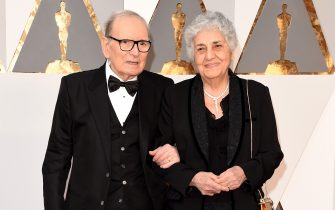 HOLLYWOOD, CA - FEBRUARY 28:  Italian composer Ennio Morricone and his wife Maria Travia attend the 88th Annual Academy Awards at Hollywood & Highland Center on February 28, 2016 in Hollywood, California.  (Photo by Jason Merritt/Getty Images)