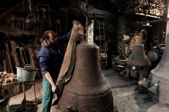 Agnone, Italy - Pasquale, worker at the Marinelli Pontificial foundry in Agnone, portrayed as he works on the modelling of a series of bells in production at the Marinelli Pontificail foundry.