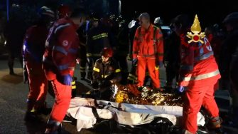 The image grabbed from a video made available by the Italian Fire Department shows emergency personnel attending to victims of a stampede at the nightclub 'Lanterna Azzurra' in Corinaldo, near Ancona, central Italy, 08 December 2018. A stampede outside the nightclub has killed six people and injured more than 100, after someone probably caused a panic with a stinging spray The incident took place at a packed club hosting a concert by popular Italian rapper Sfera Ebbasta. ANSA/ ITALIAN FIRE DEPARTMENT +++ HO - NO SALES, EDITORIAL USE ONLY +++