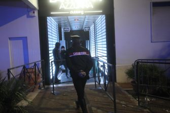 A Carabiniere officer enters the nightclub 'Lanterna Azzurra' in Corinaldo, near Ancona, central Italy, 08 December 2018. A stampede that occurred overnight outside the nightclub killed six people and injured more than 100, after someone probably caused a panic with a stinging spray. The incident took place at the packed club hosting a concert by popular Italian rapper Sfera Ebbasta. ANSA/ STRINGER
