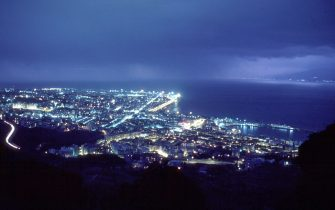 REGGIO, ITALY - CIRCA JULY 2003:  (FILE-PHOTO)  (ITALY-OUT)  A general view of the strait of Messina, taken from the town of Reggio Calabria, with the lights of Messina, Italy, on the upper right of the frame, are shown circa July 2003 in Reggio, Calabria, Italy. The EU parliament decided March 13, 2004 to include a bridge over the Strait of Messina in its list of planned pan-European network projects. The project was approved by architect Dr. William Brown, the architect for the Bosforo bridge. The project calls for building the longest suspension bridge in the world, approximately 3,666 meters (about 2.2 miles) to link Sicily to the mainland of Italy. The bridge has been billed as a priority of the government of Prime Minister Silvio Berlusconi.  (Photo by Franco Origlia/Getty Images)